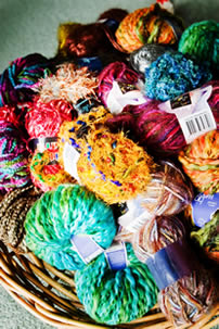 Peg keeps a large supply of textured yarns in baskets throughout her workshop